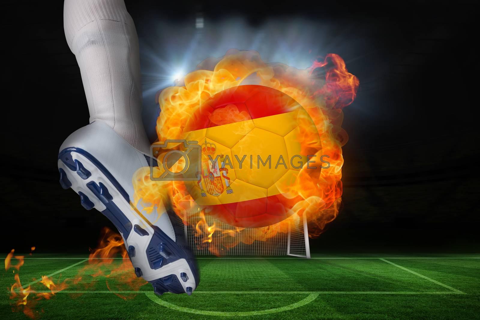 Football player kicking flaming spain flag ball by Wavebreakmedia