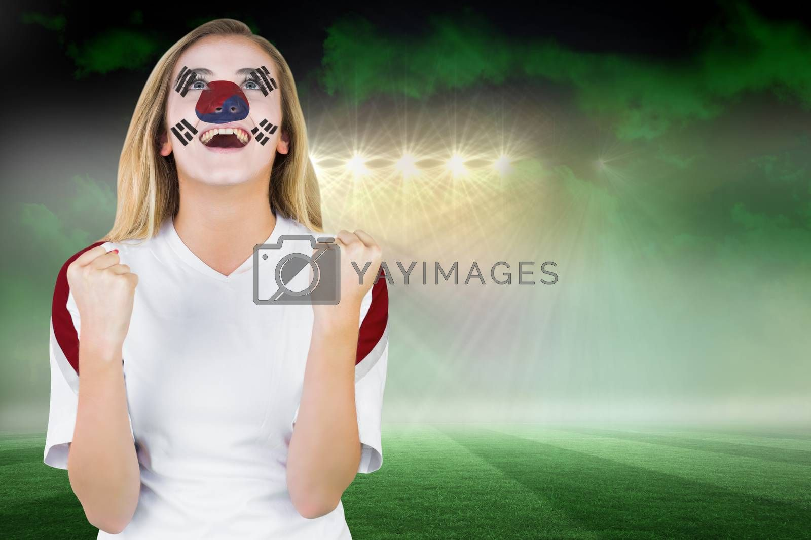 Excited south korea fan in face paint cheering by Wavebreakmedia