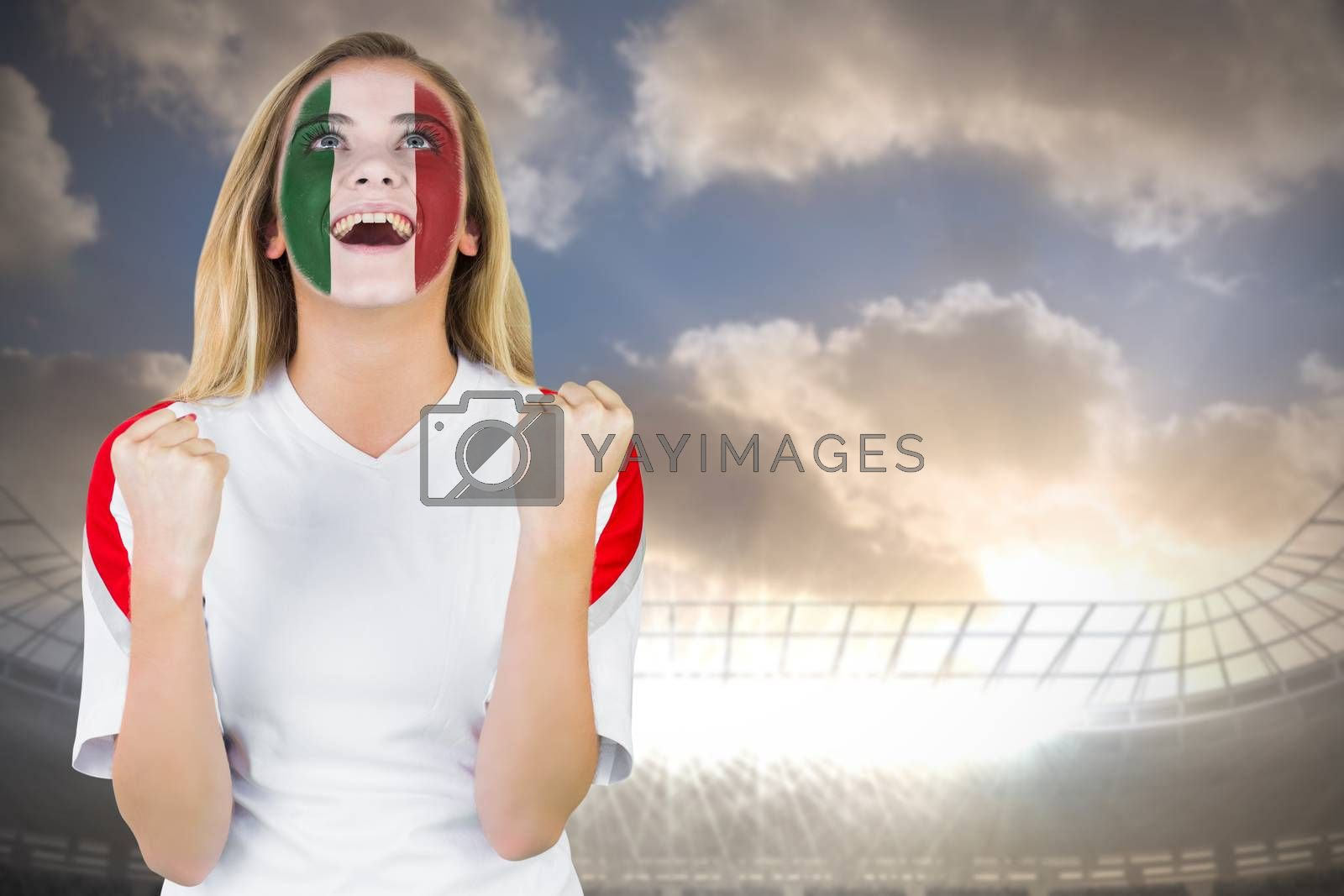 Excited italy fan in face paint cheering by Wavebreakmedia
