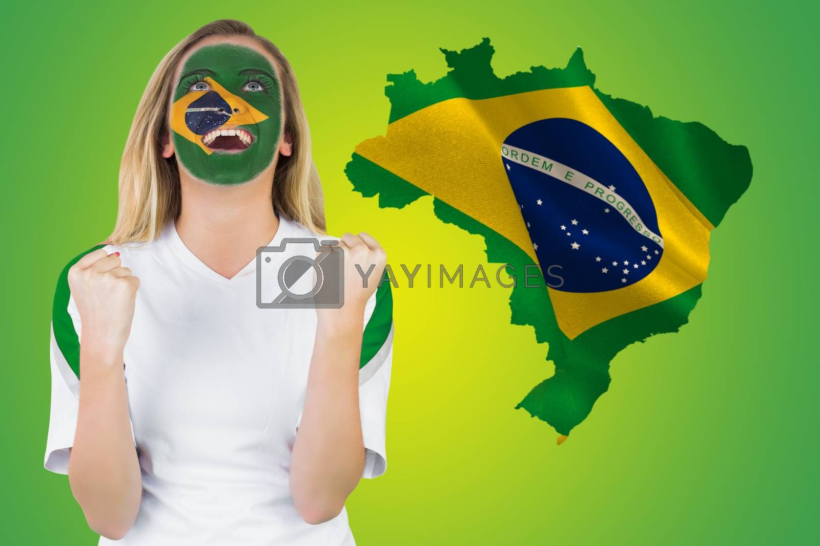 Excited brasil fan in face paint cheering by Wavebreakmedia