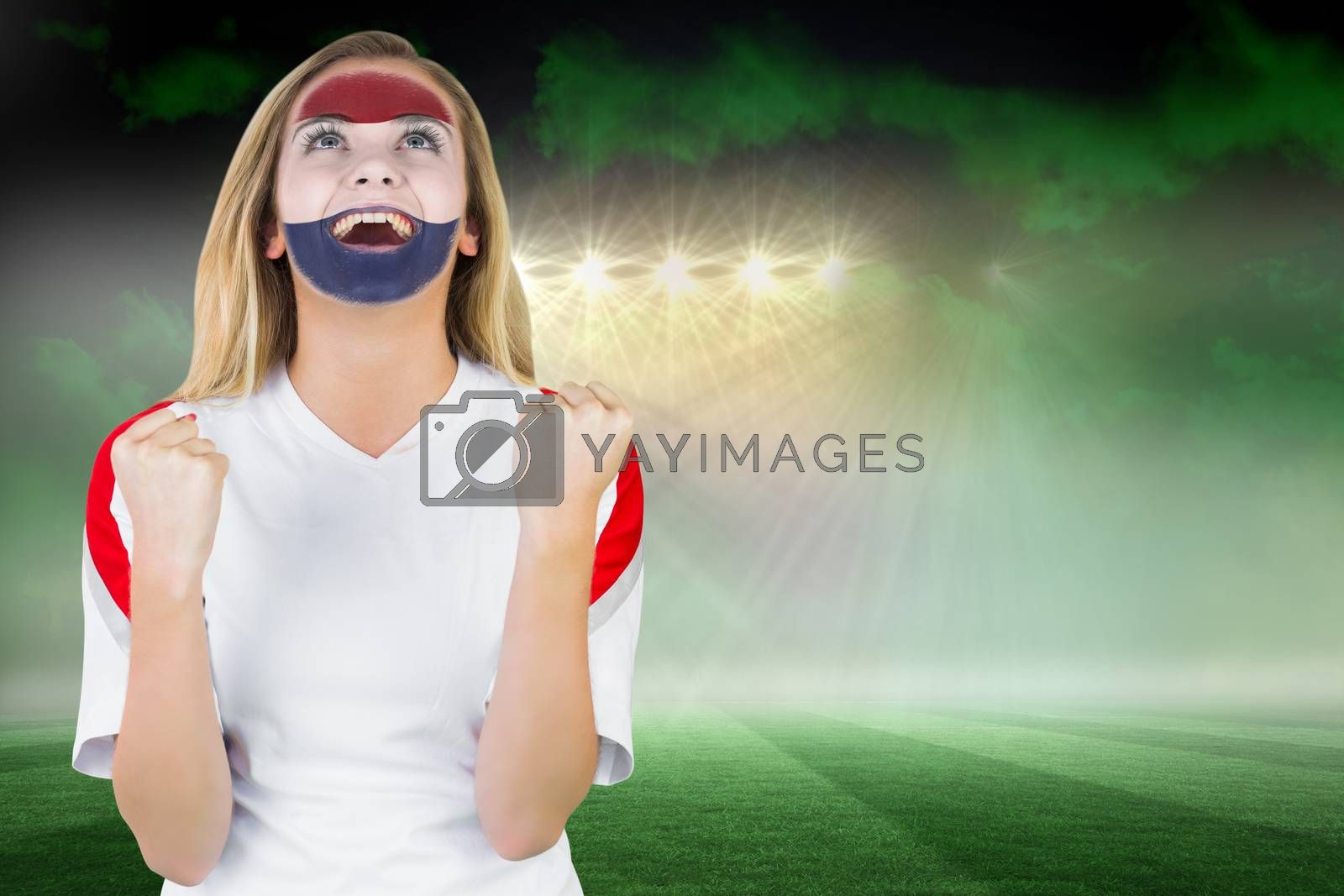 Excited netherlands fan in face paint cheering by Wavebreakmedia