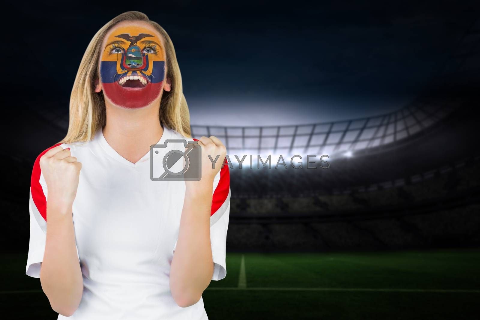 Excited ecuador fan in face paint cheering by Wavebreakmedia
