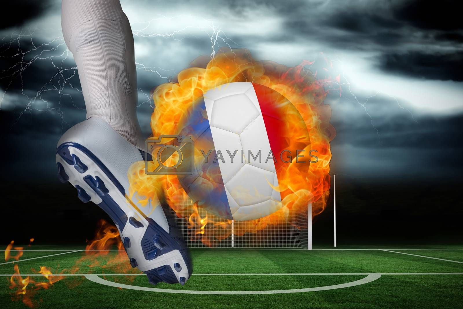 Football player kicking flaming france flag ball by Wavebreakmedia