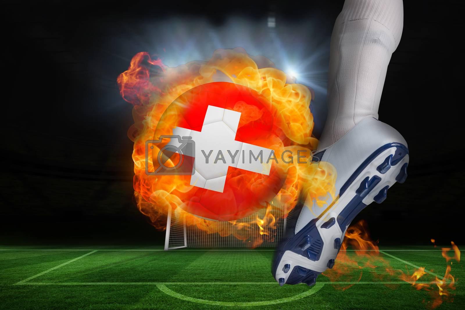 Football player kicking flaming swiss flag ball by Wavebreakmedia