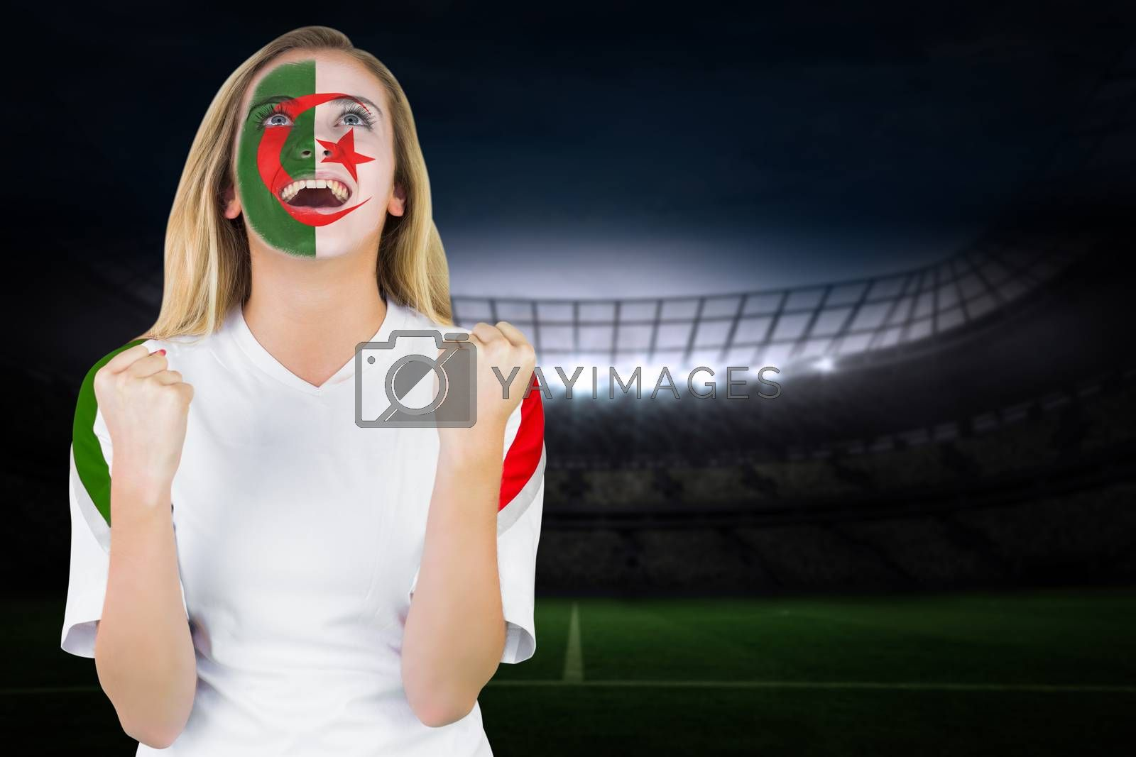 Excited iran fan in face paint cheering by Wavebreakmedia
