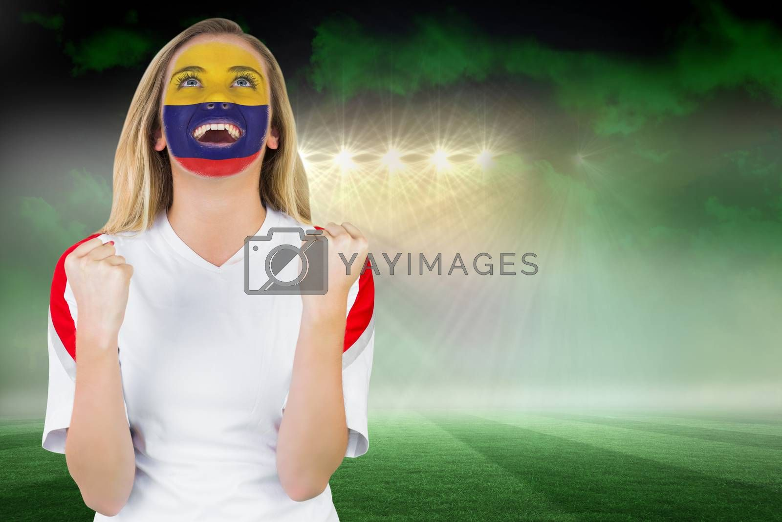 Excited colombia fan in face paint cheering by Wavebreakmedia