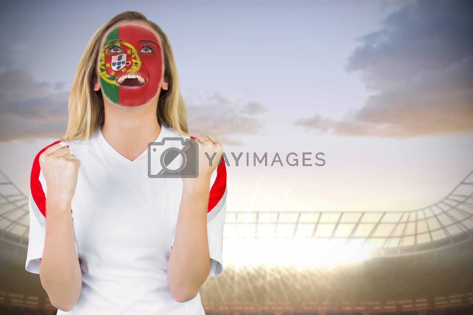 Excited portugal fan in face paint cheering by Wavebreakmedia