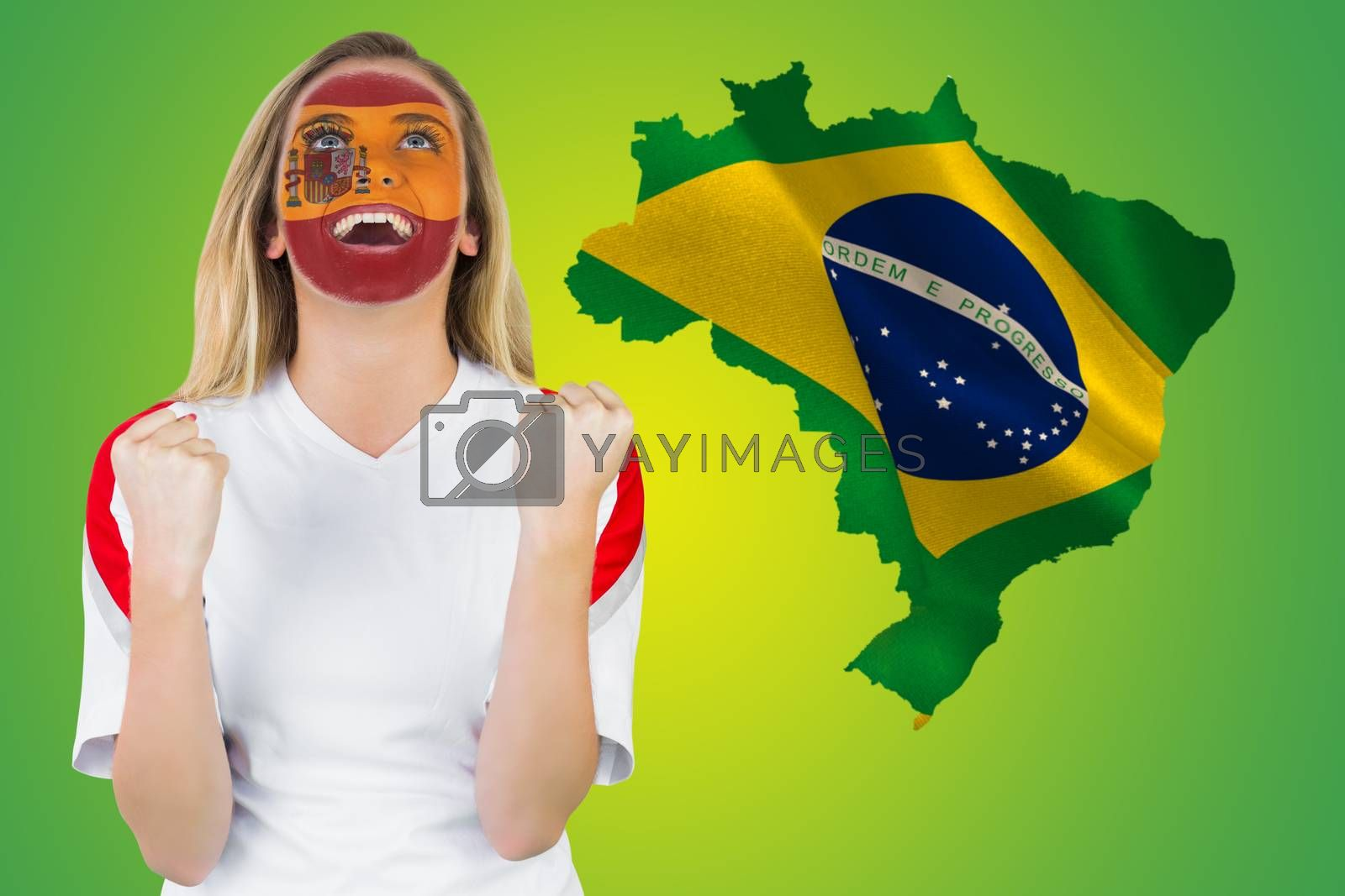 Excited spain fan in face paint cheering by Wavebreakmedia