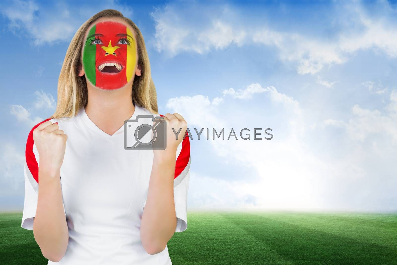 Excited cameroon fan in face paint cheering by Wavebreakmedia