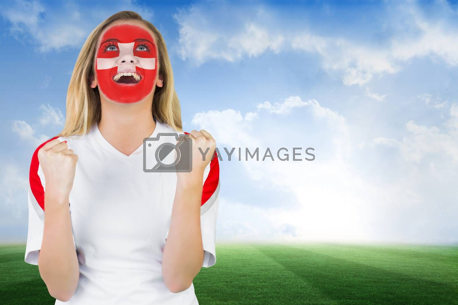 Excited fan in swiss face paint cheering by Wavebreakmedia