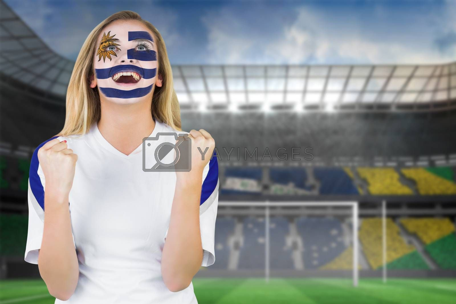 Excited fan in uruguay face paint cheering by Wavebreakmedia