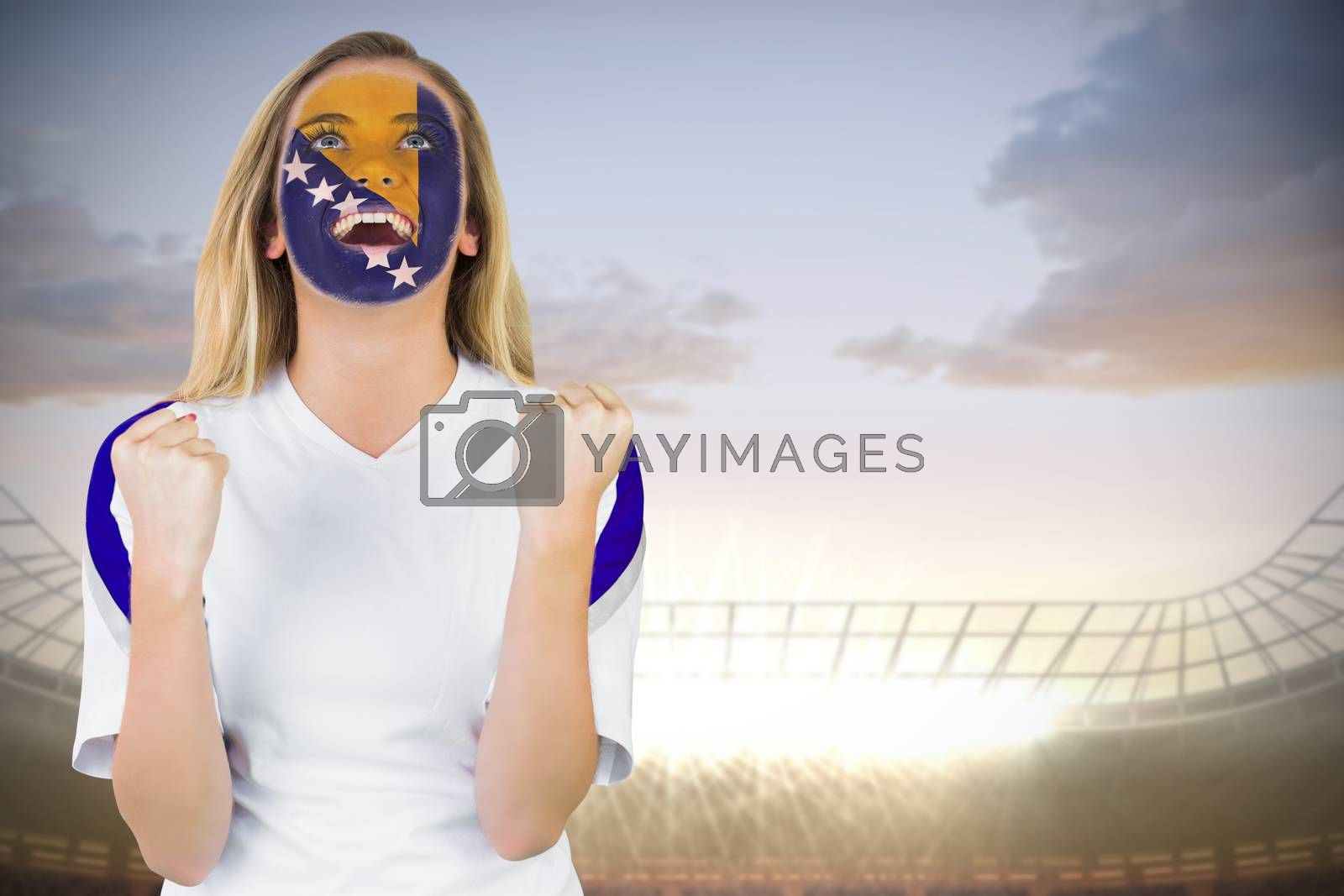 Excited bosnia fan in face paint cheering by Wavebreakmedia