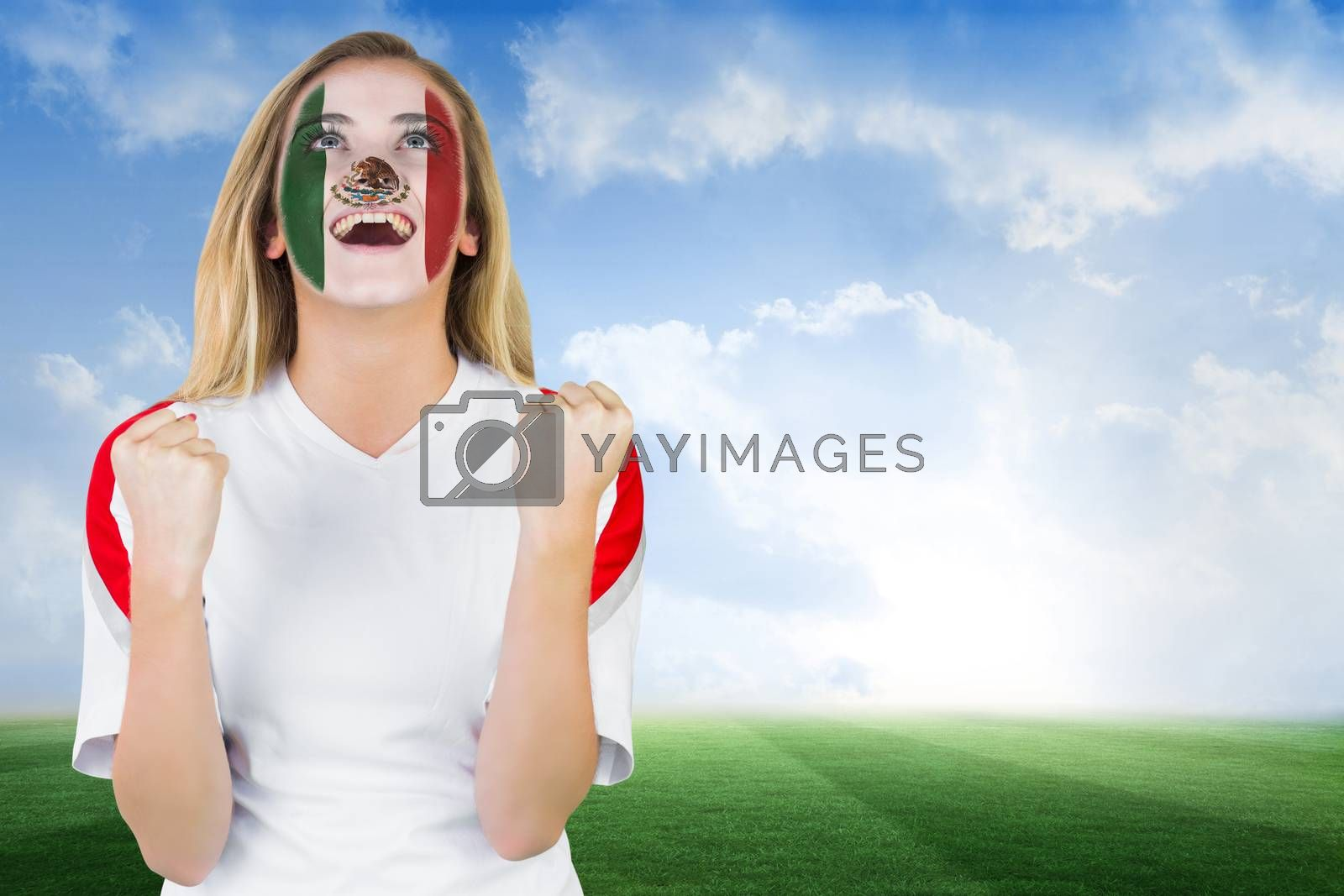 Excited mexico fan in face paint cheering by Wavebreakmedia