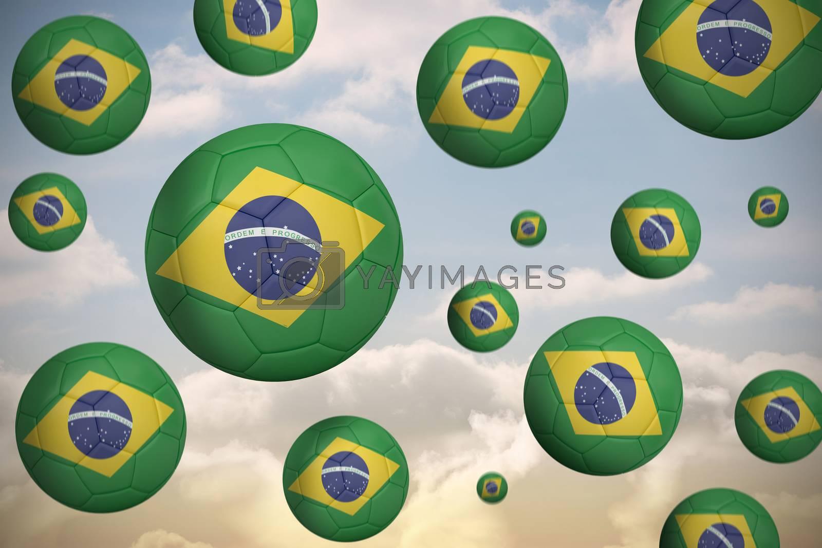 Footballs in brasil flag colours  by Wavebreakmedia