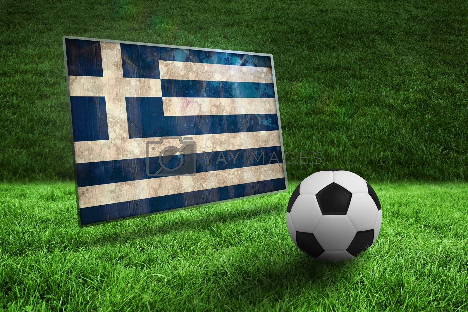 Black and white football on grass by Wavebreakmedia