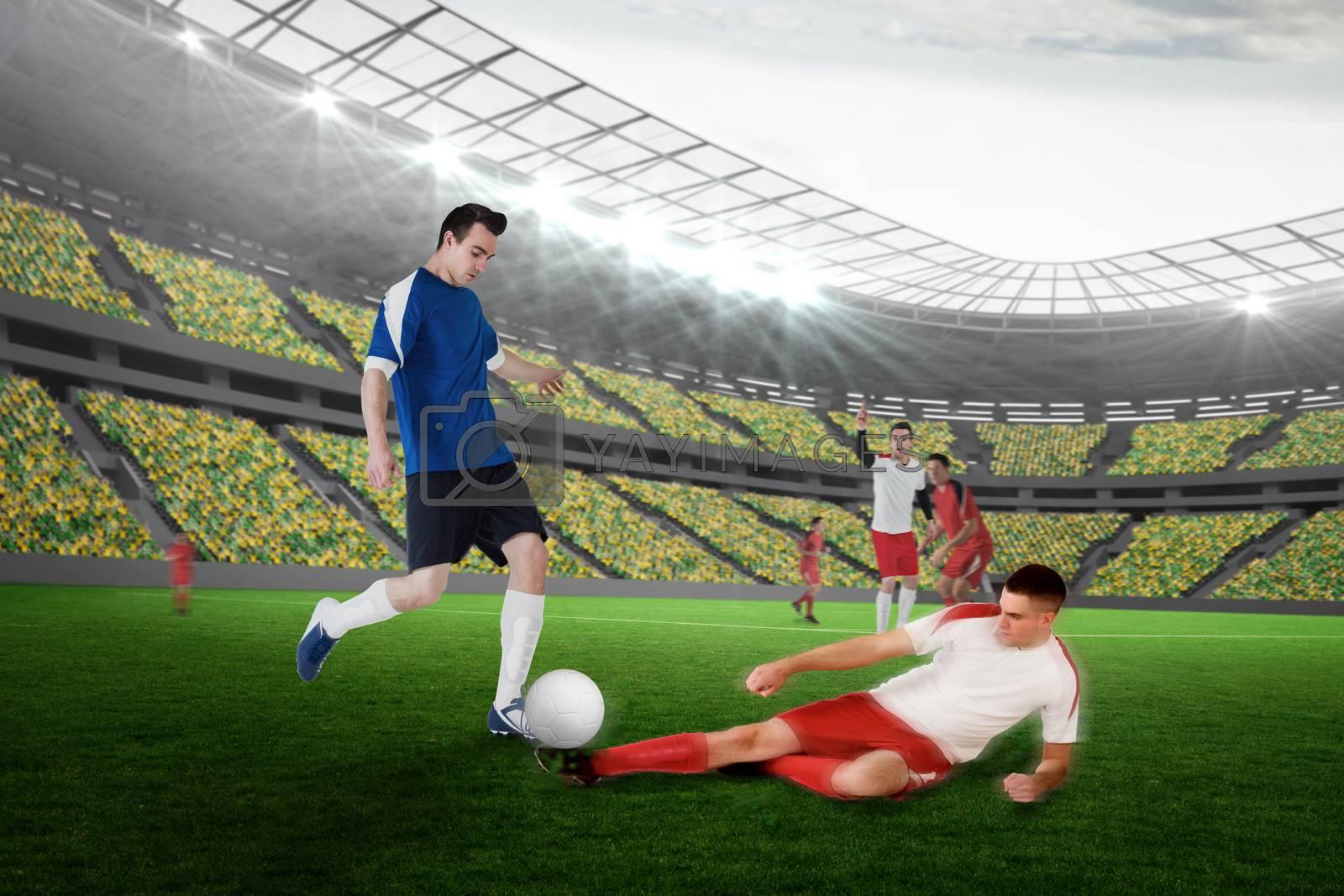 Football player in blue kicking by Wavebreakmedia