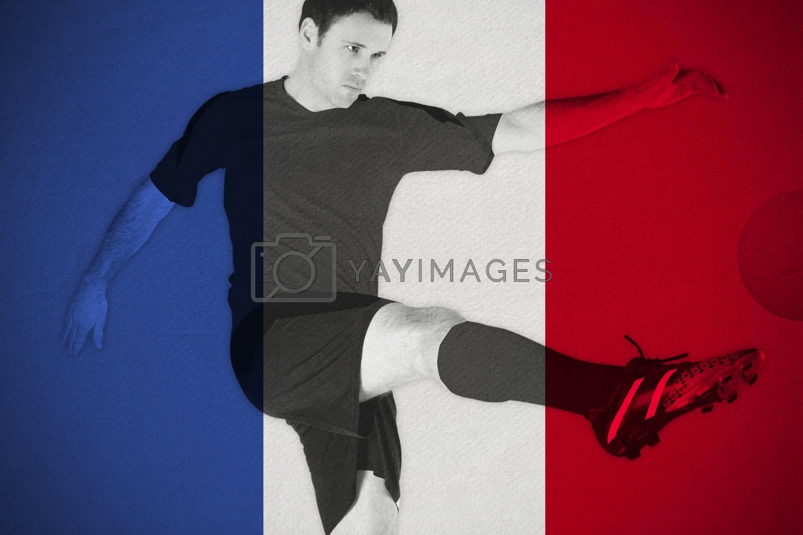 Football player in white kicking by Wavebreakmedia