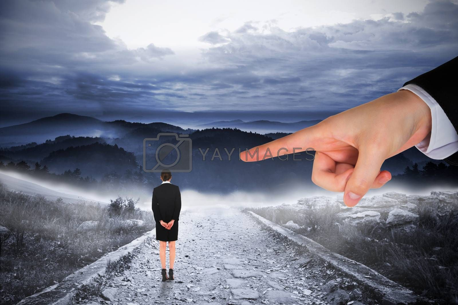 Giant hand pointing at businesswoman by Wavebreakmedia