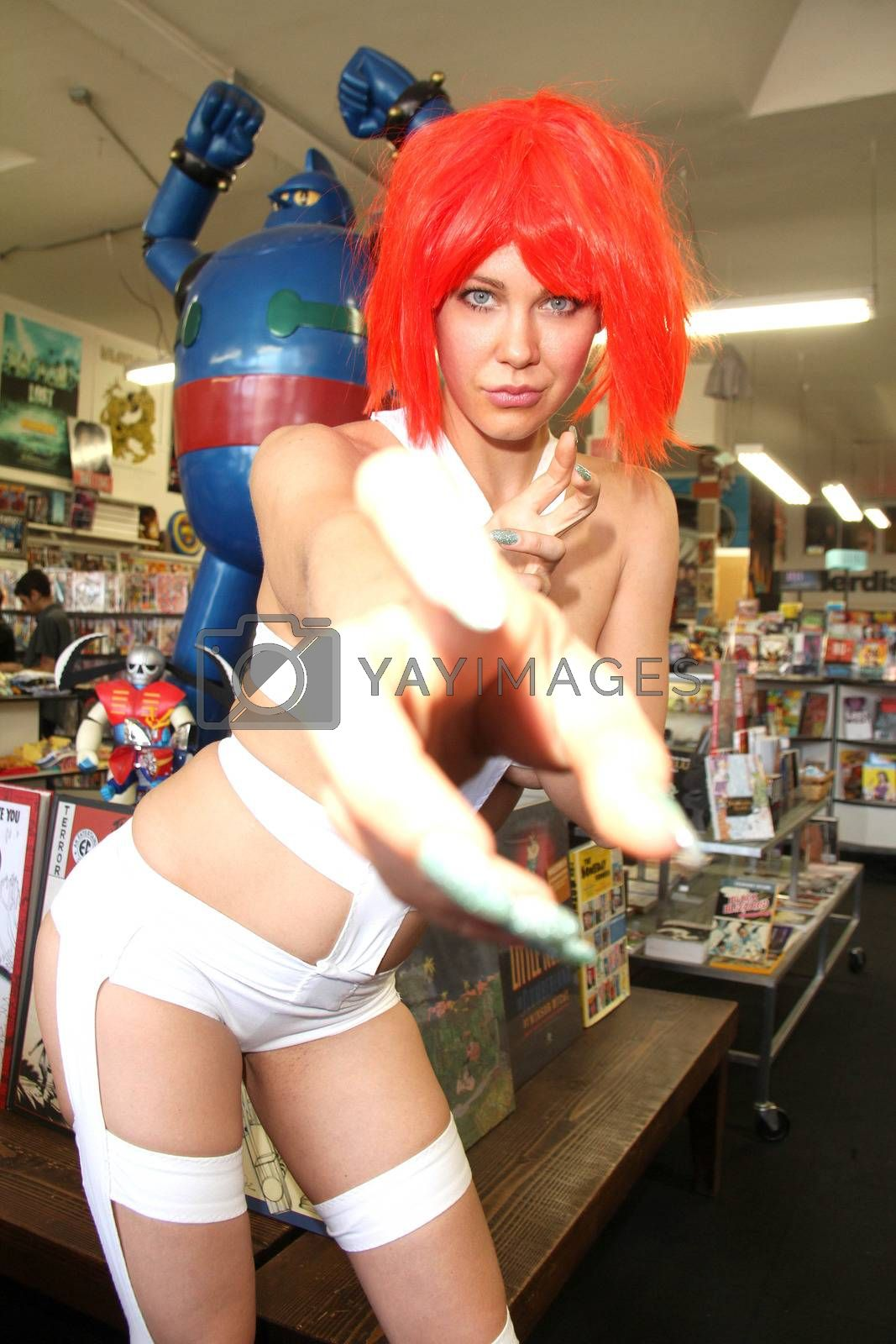"""Maitland Ward trying out her """"Leeloo"""" costume from the Fifth Element before going to Long Beach Comic-Con, Meltdown Comics, Los Angeles, CA 05-31-14/ImageCollect by ImageCollect"""