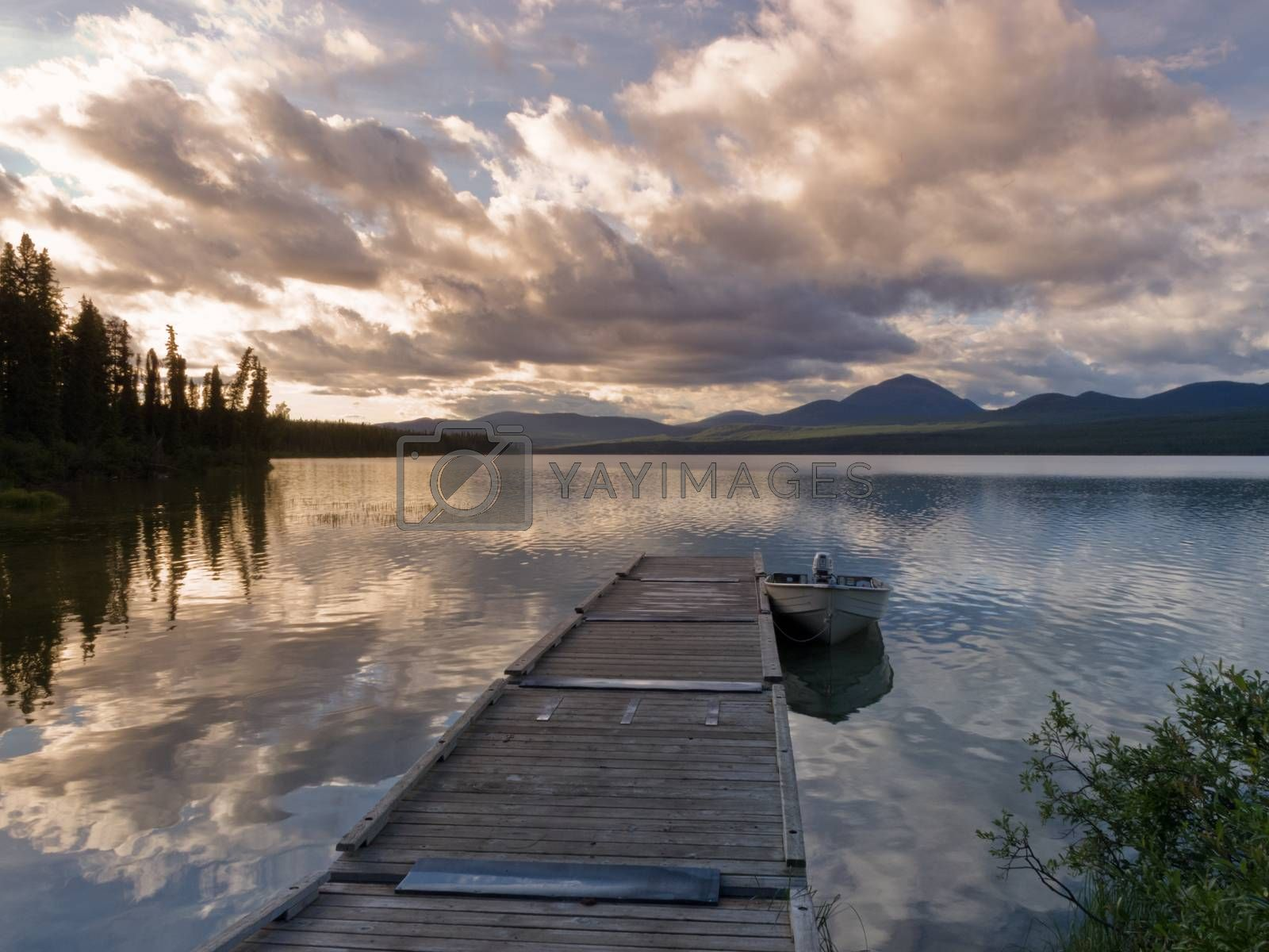Rustic wooden float dock jetty boat tranquil lake by PiLens