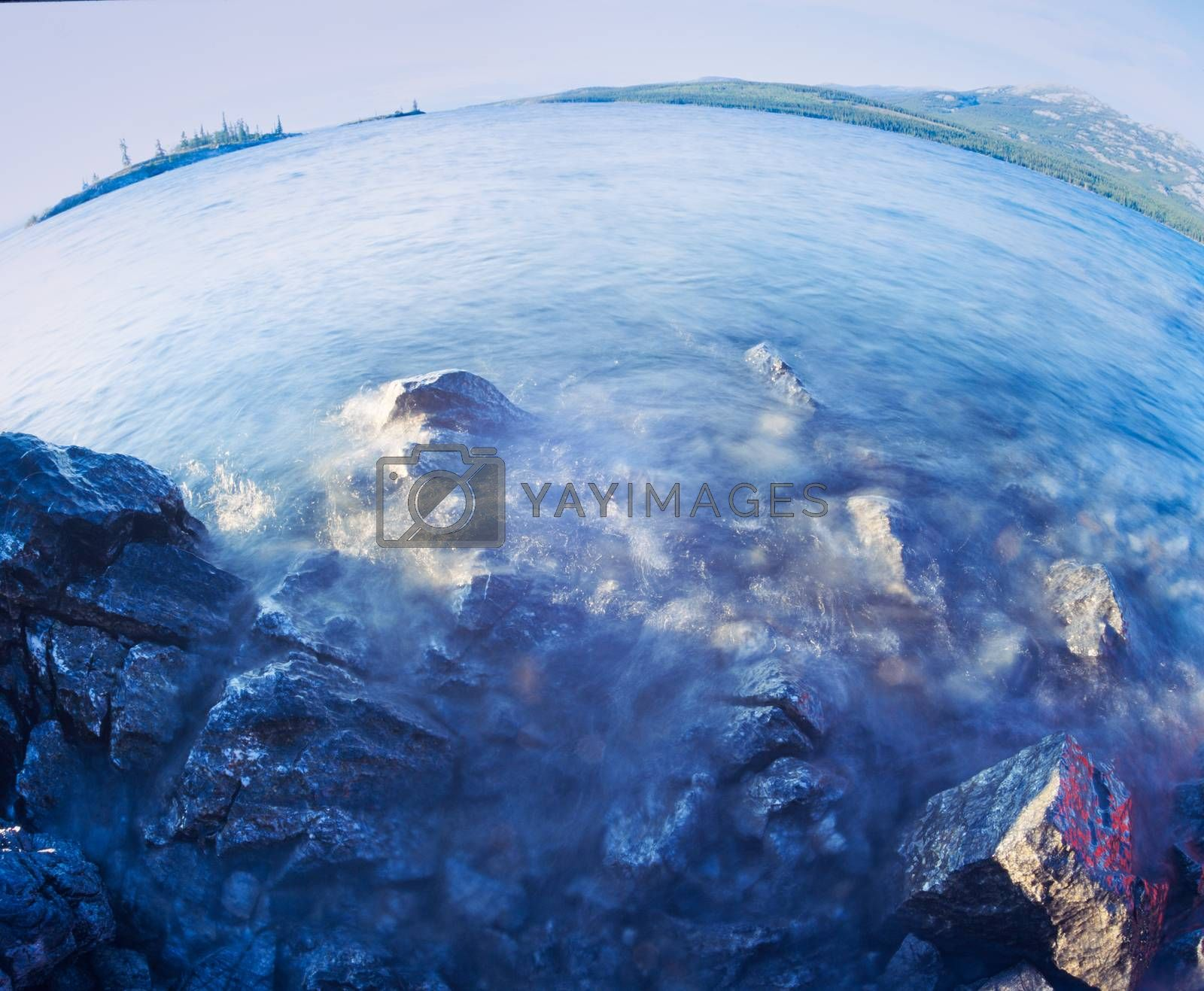 Extreme fisheye wide angle view of Tagish Lake water surface landscape, Yukon Territory, Canada
