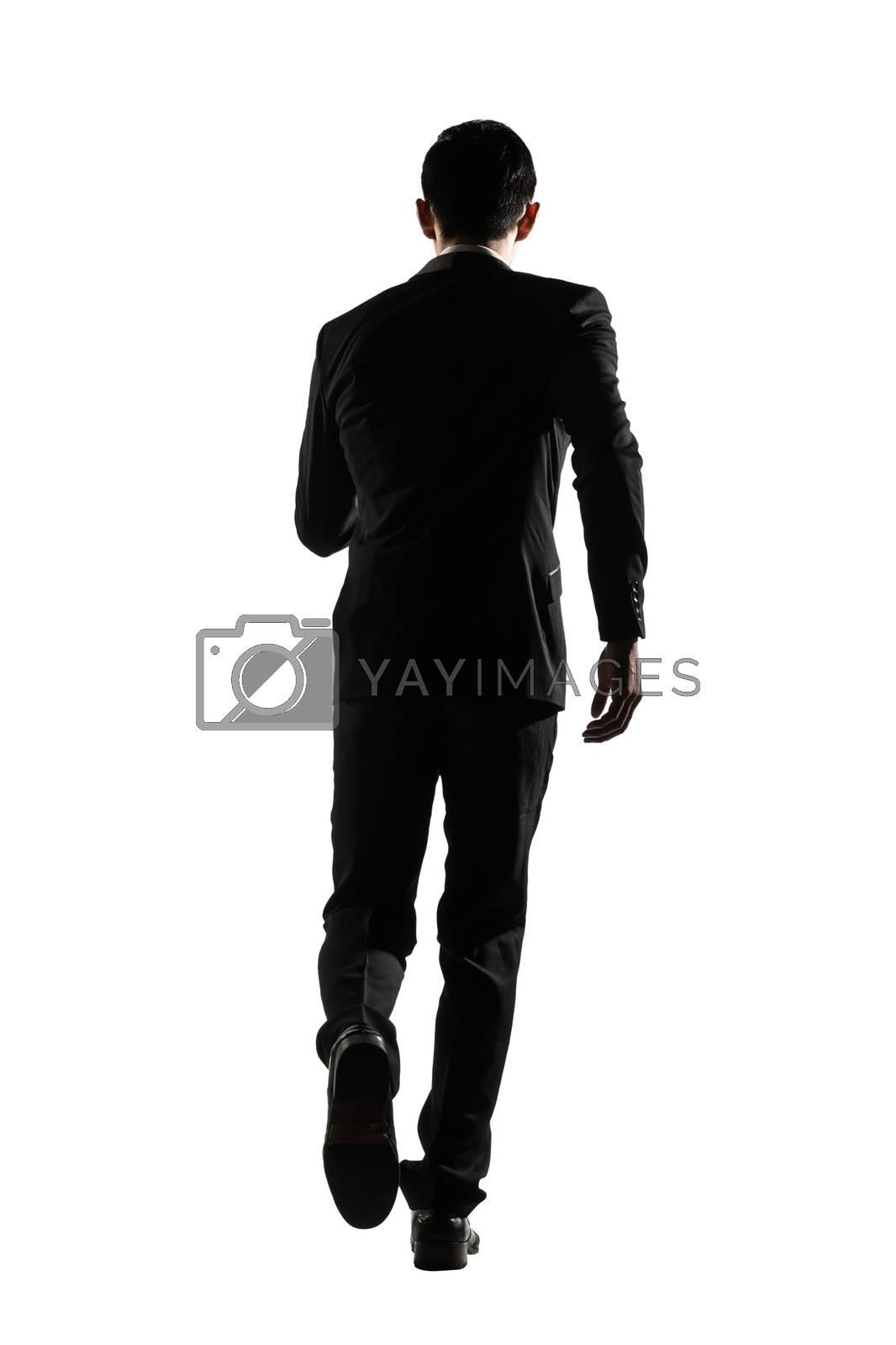 rear view of business man running by elwynn