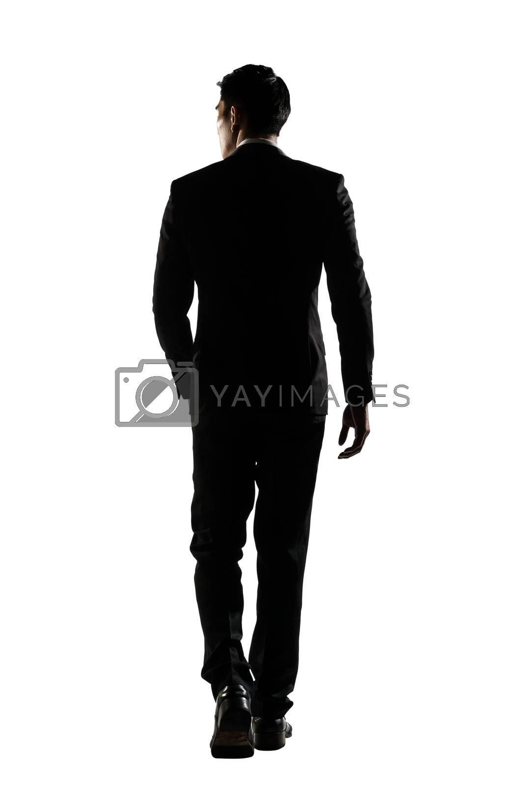 rear view of business man walk by elwynn