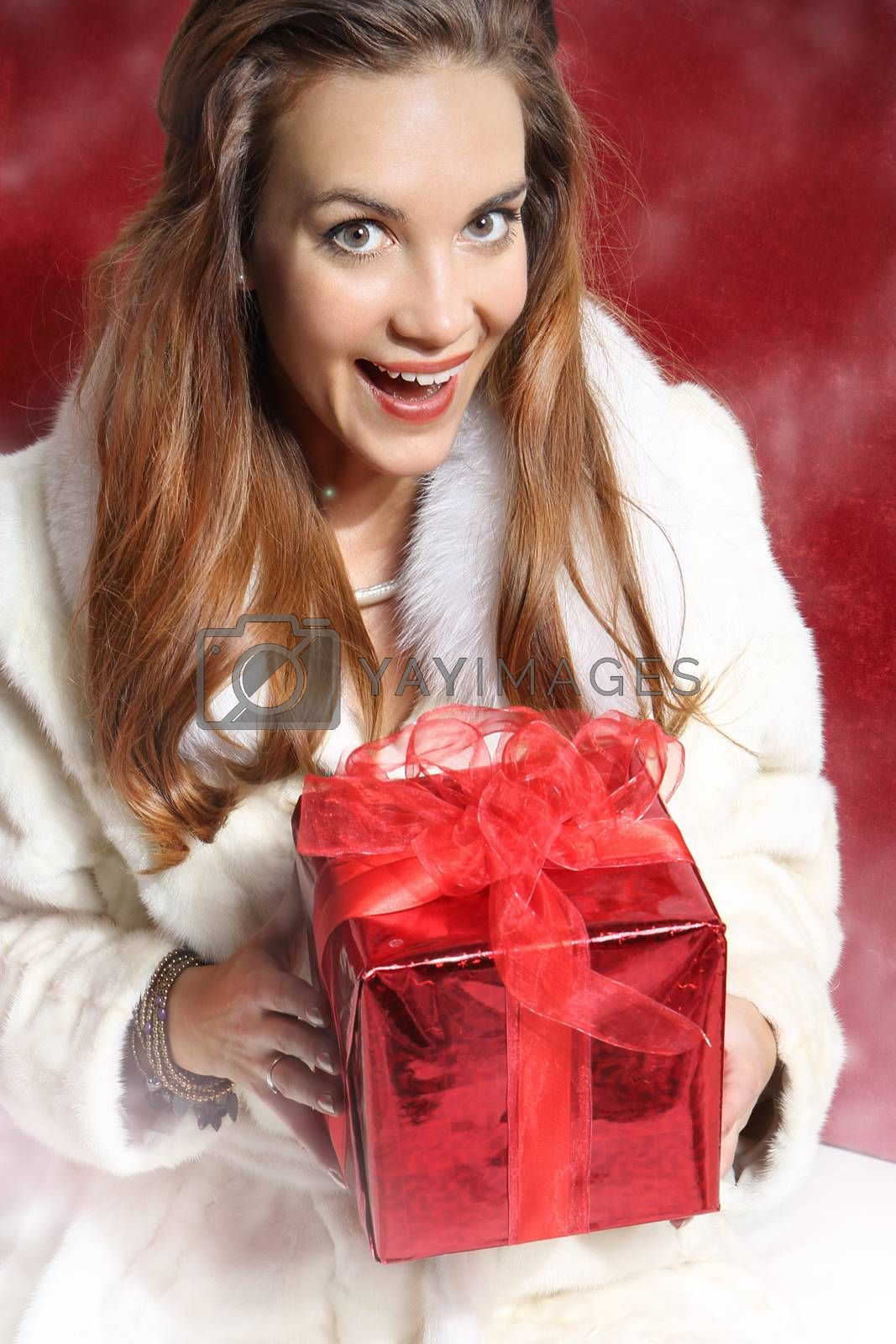 Beautiful Christmas woman in a white fur coat by Robert Przybysz