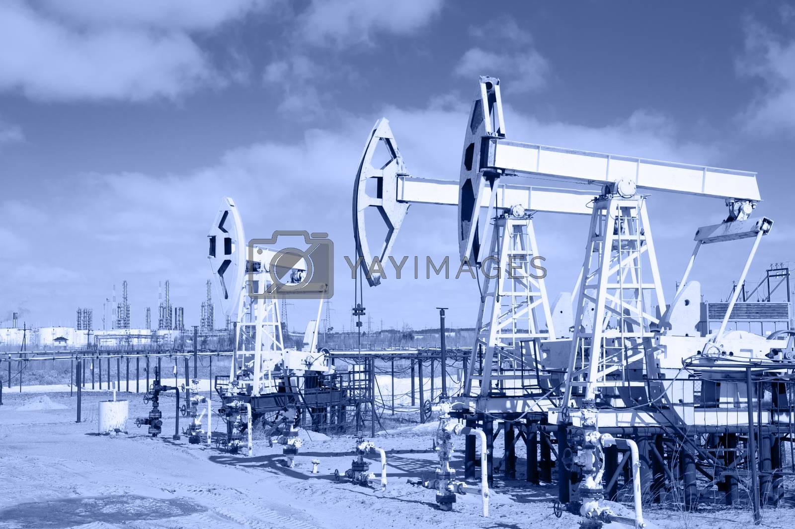 Pump jack on a oilfield. by bashta