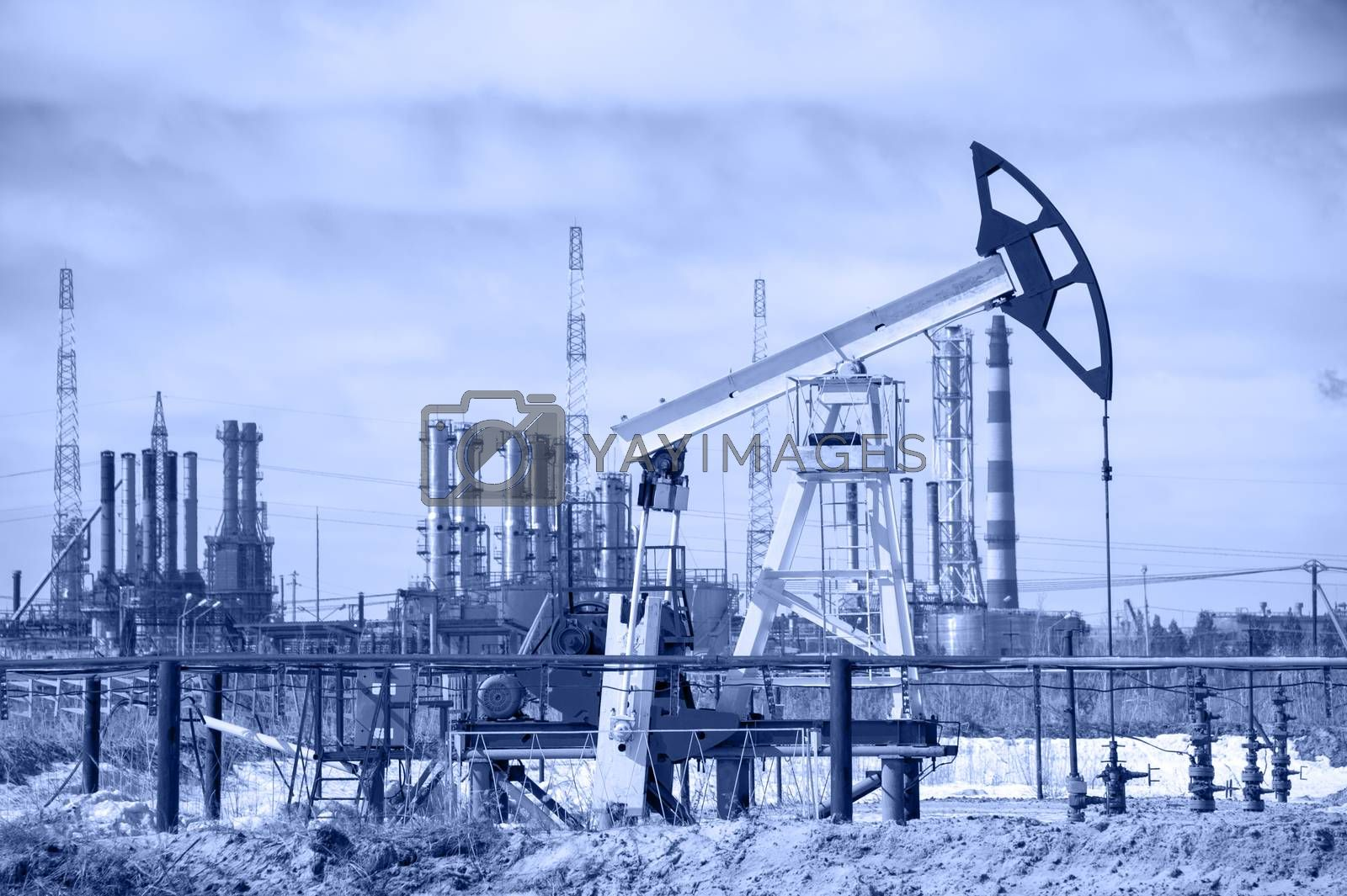 Pump jack and oil refinery. Toned. by bashta