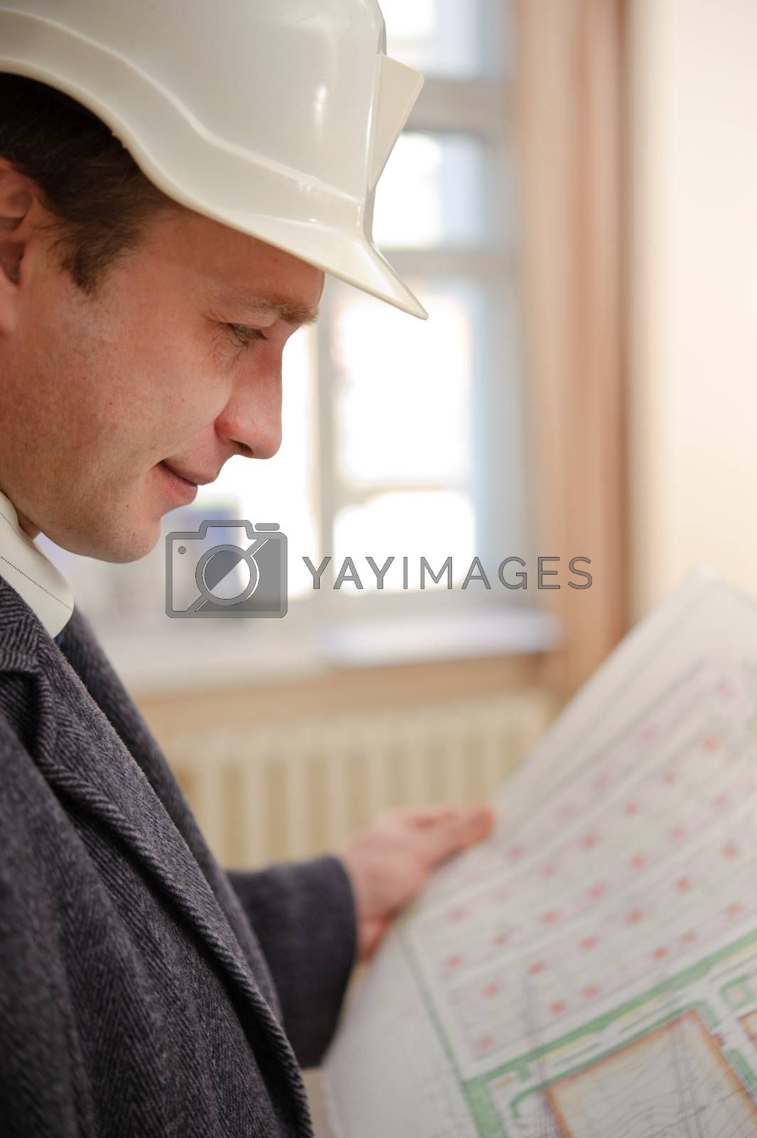 Engineer looking at plans. by bashta