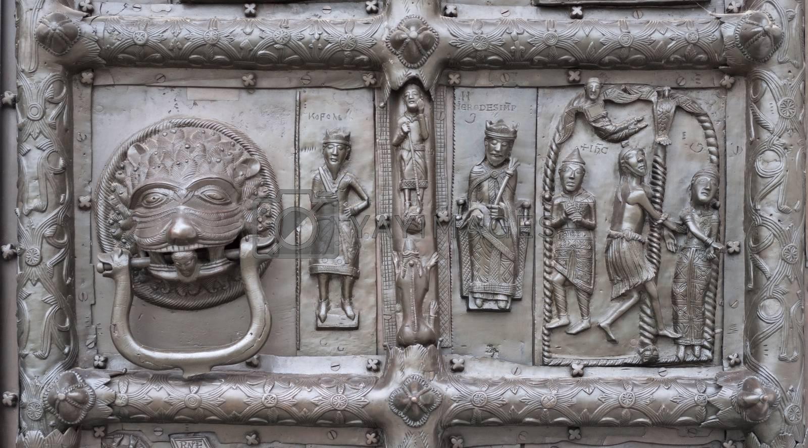 Door knocker of ancient bronze gates of Magdeburg in Veliky Novgorod, Russia. Fragment of bas-relief