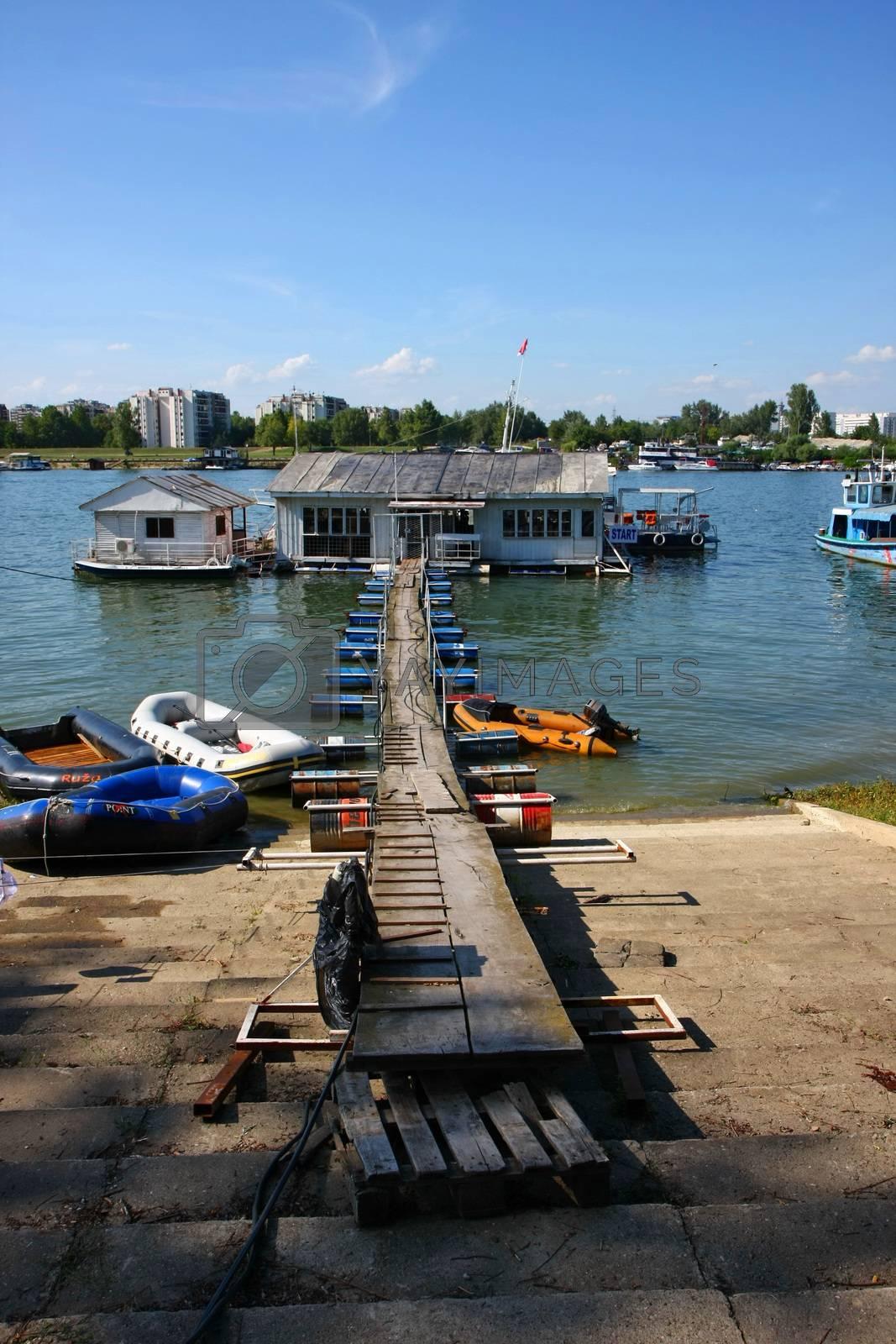 Houses and scrappy pontoon bridge on Sava river,Belgrade,Serbia