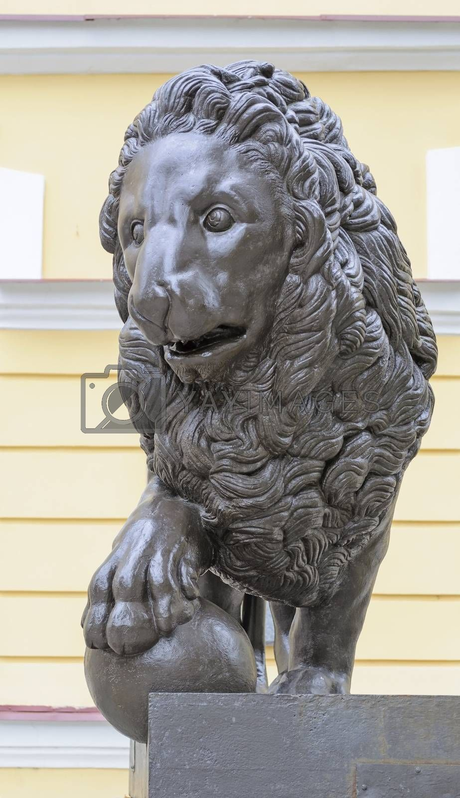 Bronze sculpture of lion with ball near the Novgorod State Museum, Russia