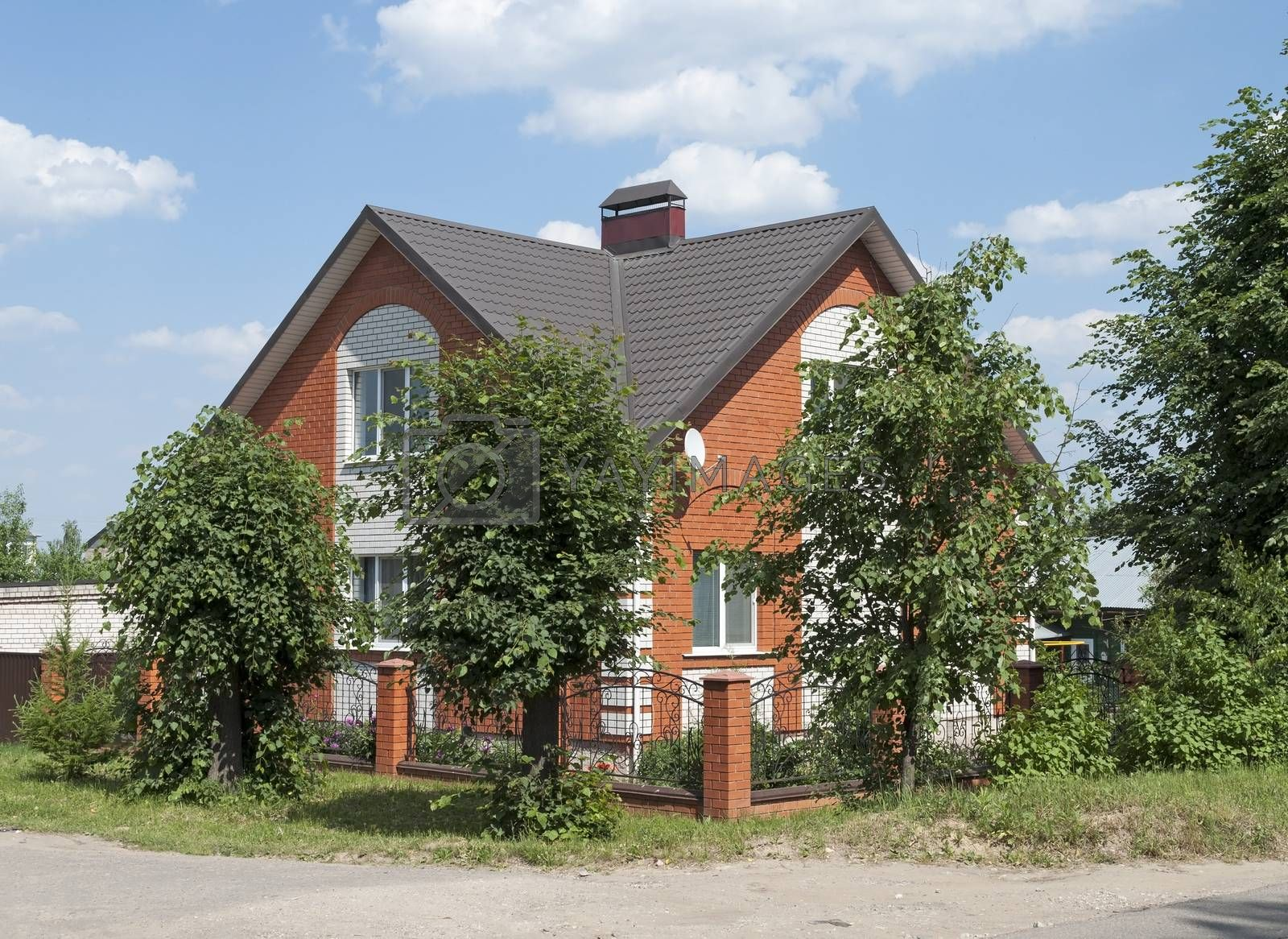 New red brick house, sunny summer day