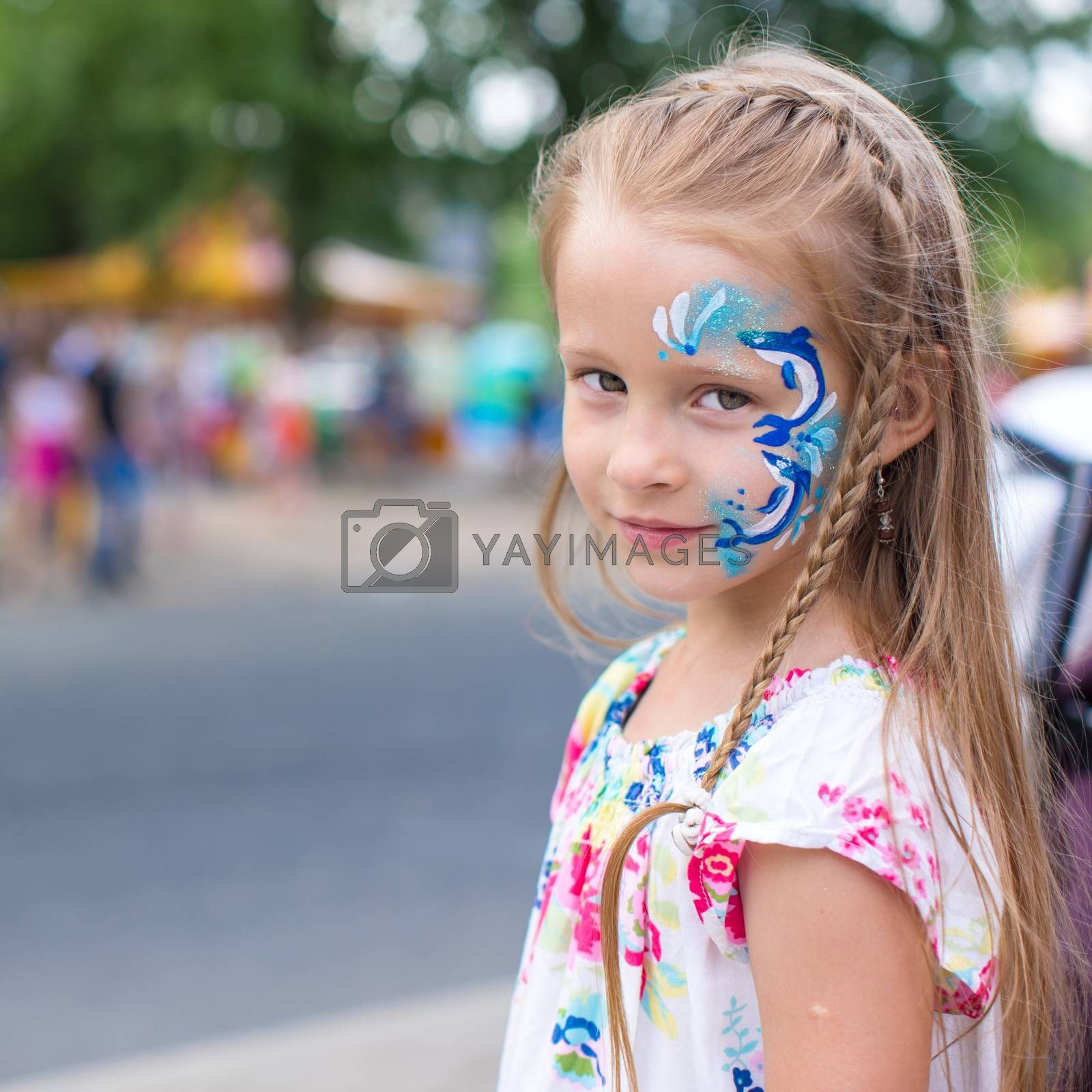 Little cute girl  with pattern on the face outdoor