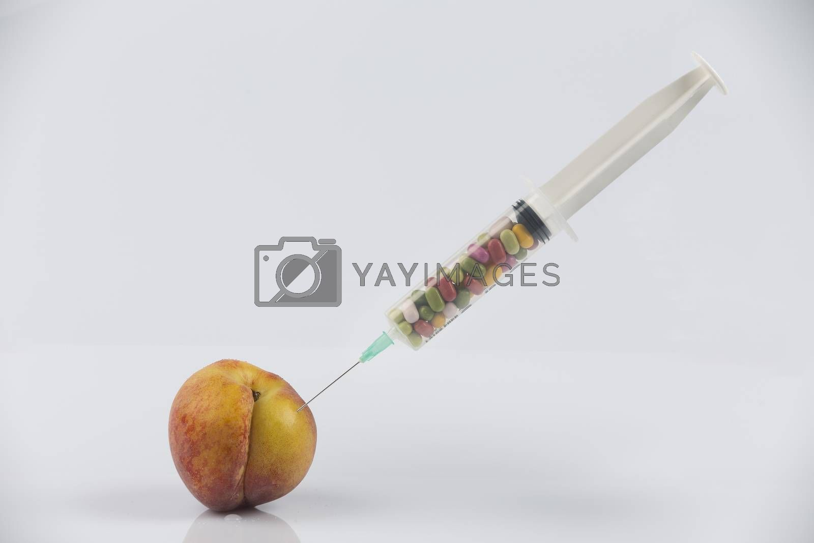 Female menopause and sexual disease metaphor: peach and syringe with meaning cosmetic and health treatment for female ageing