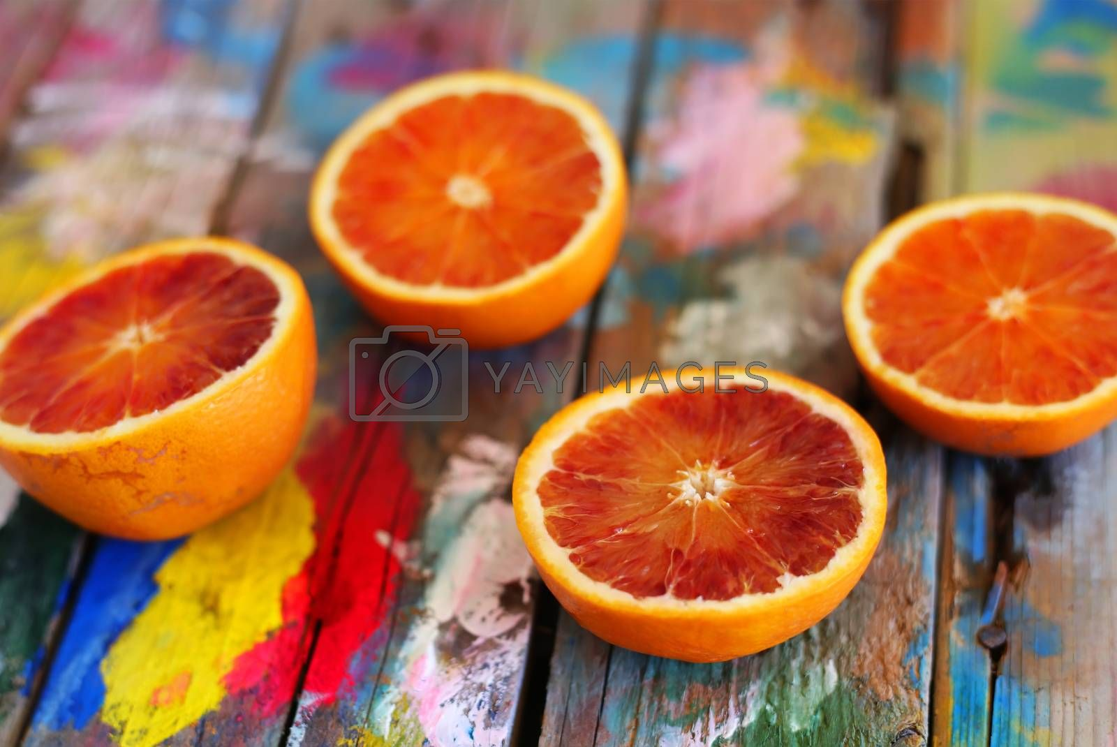 This is a photo of oranges on multi colored background