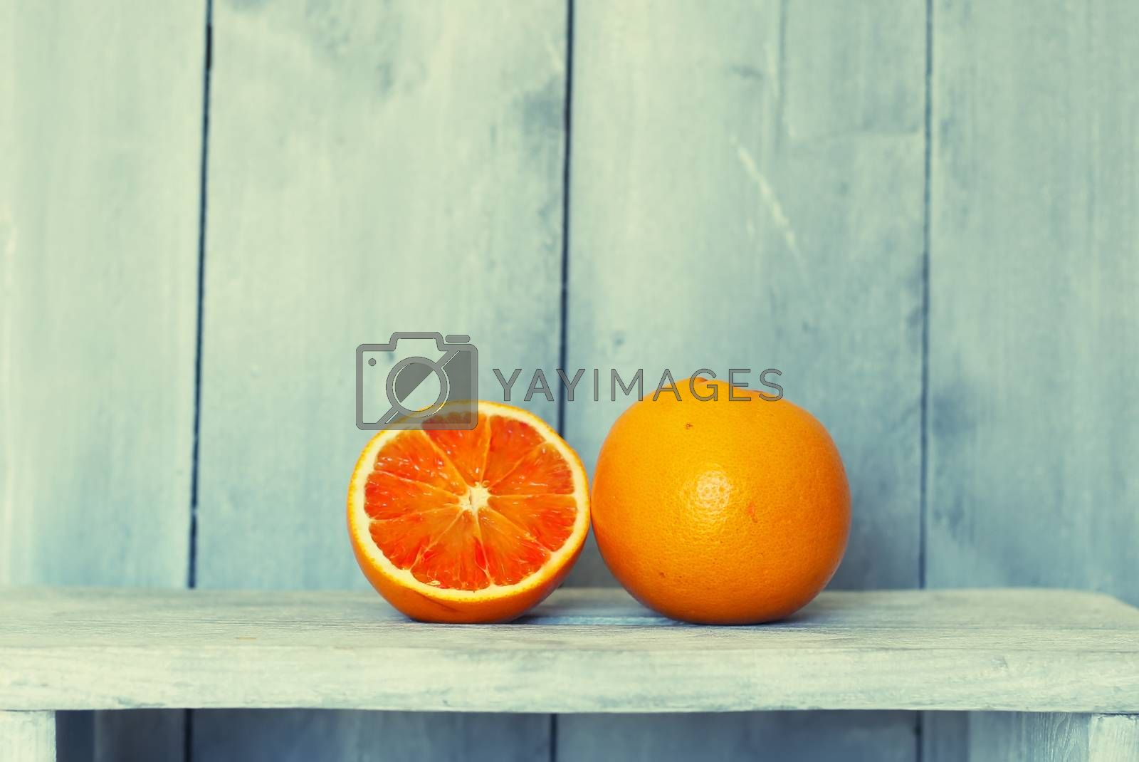 This is a photo of oranges on wooden background