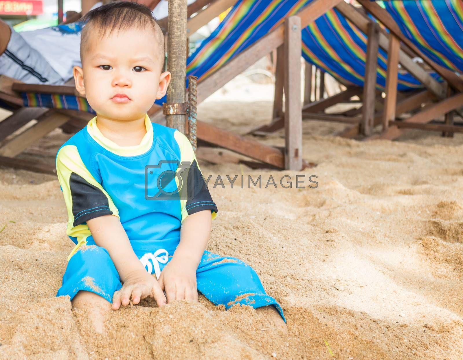 Asian boy playing on the beach, stock photo