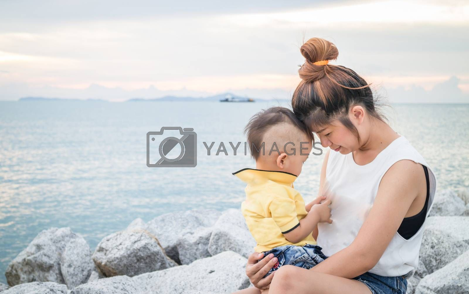 Cute asian boy playing with his mother, stock photo