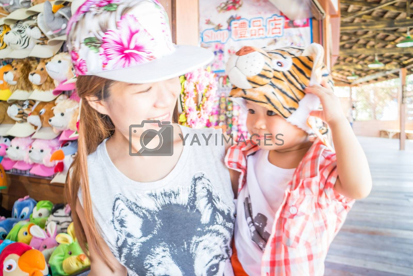Asian boy enjoy playing with his mother, stock photo