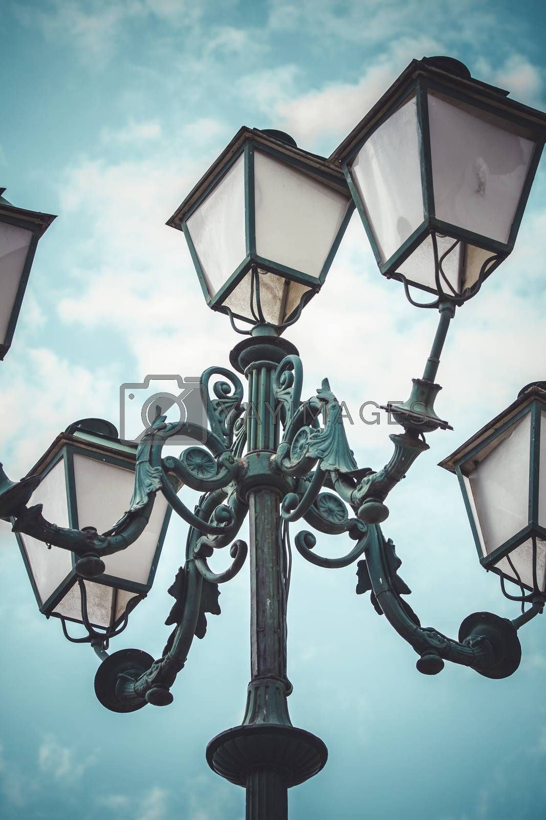 romantic, traditional street lamp with decorative metal flourishes