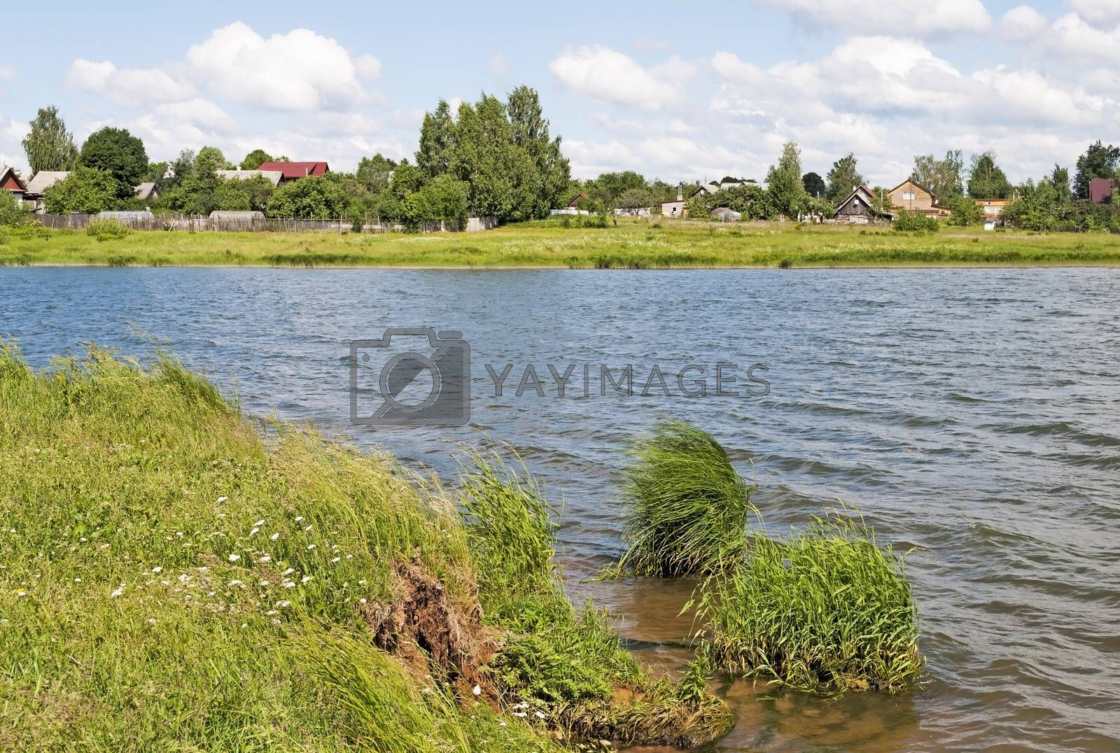 Village on the river in summer time, Russia