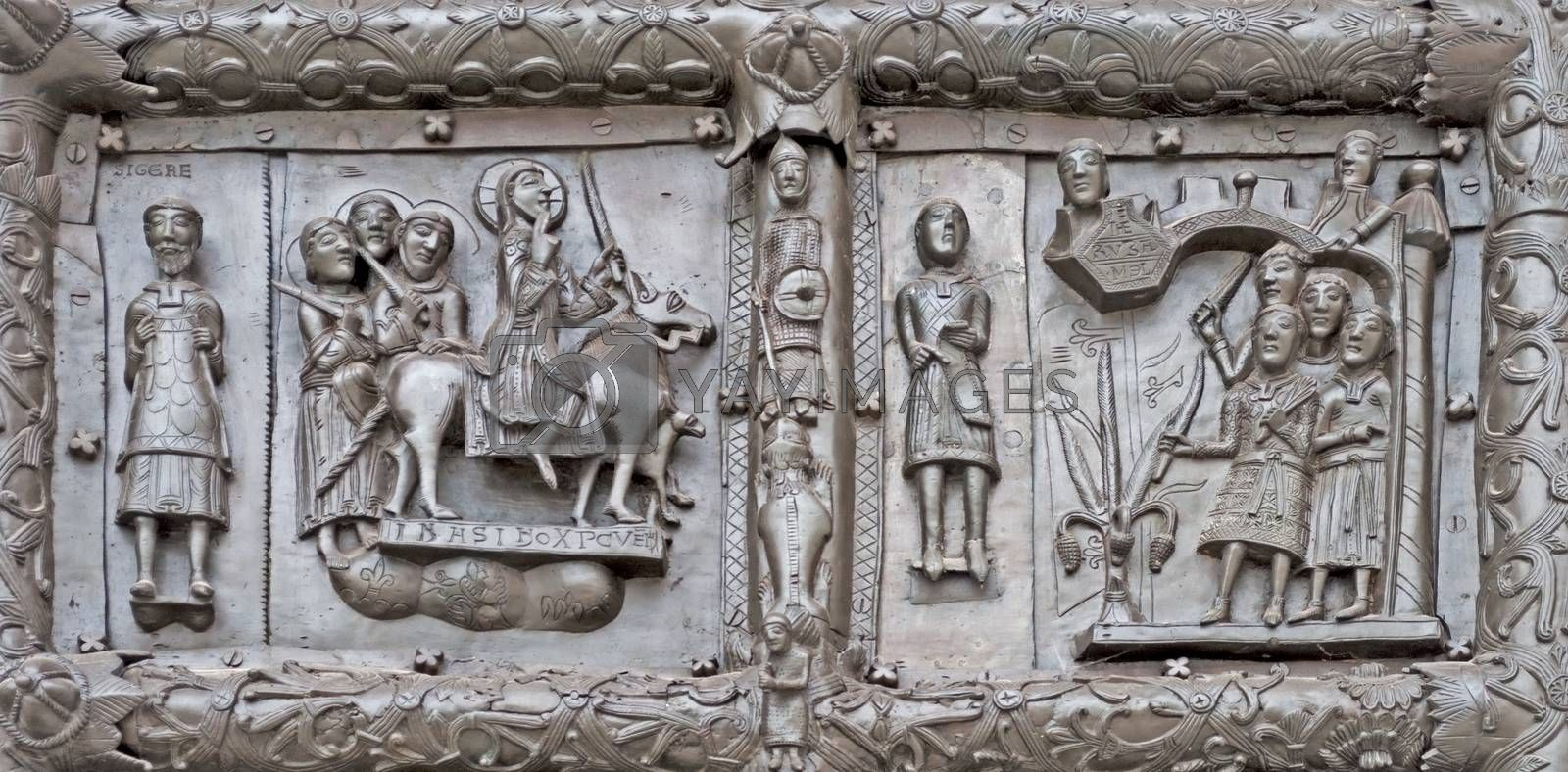 Ancient bronze gates of Magdeburg in Veliky Novgorod, Russia. Fragment of the bas-relief with Jesus Christ and scenes from Bible.