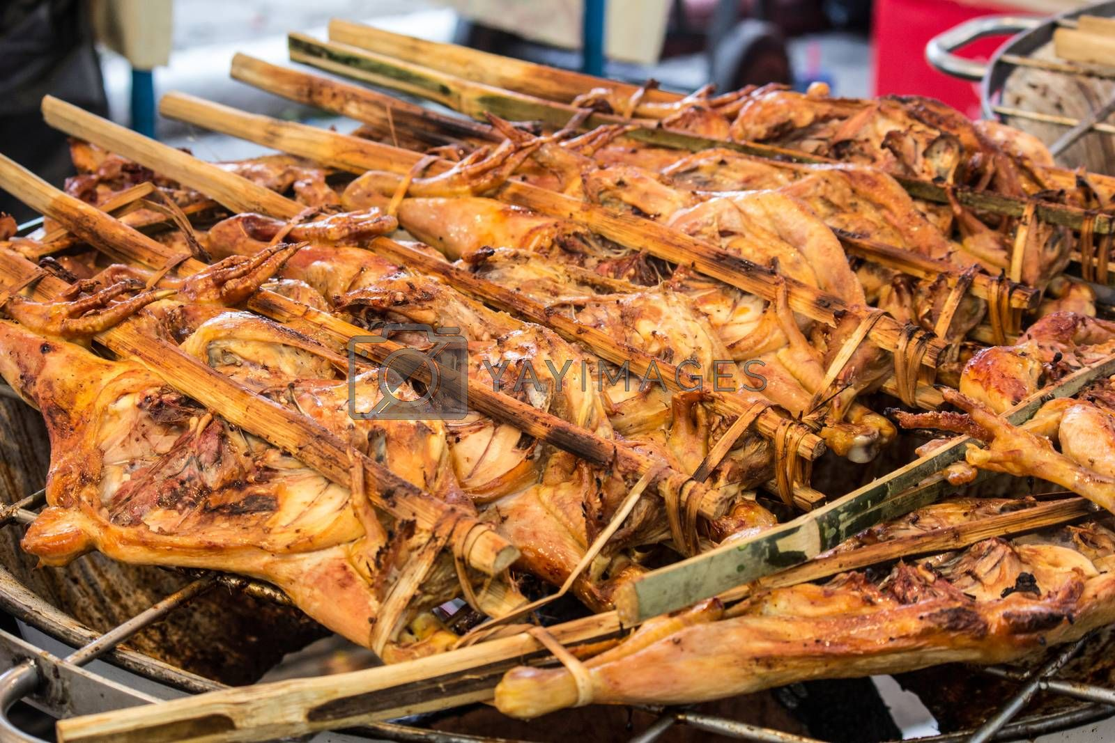 grilled chicken sold by street food vendor