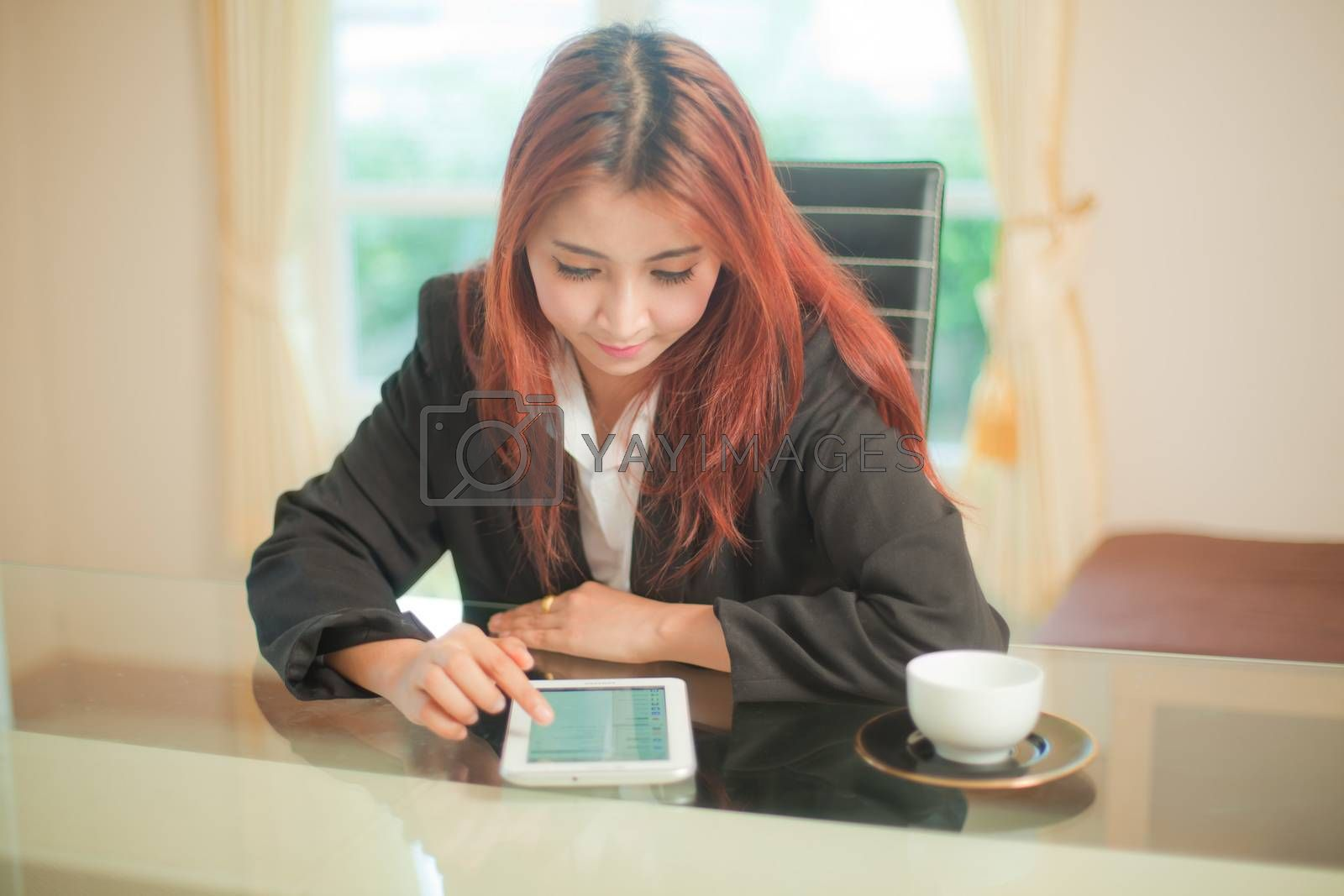 Young beautiful asian business woman using tablet at office building