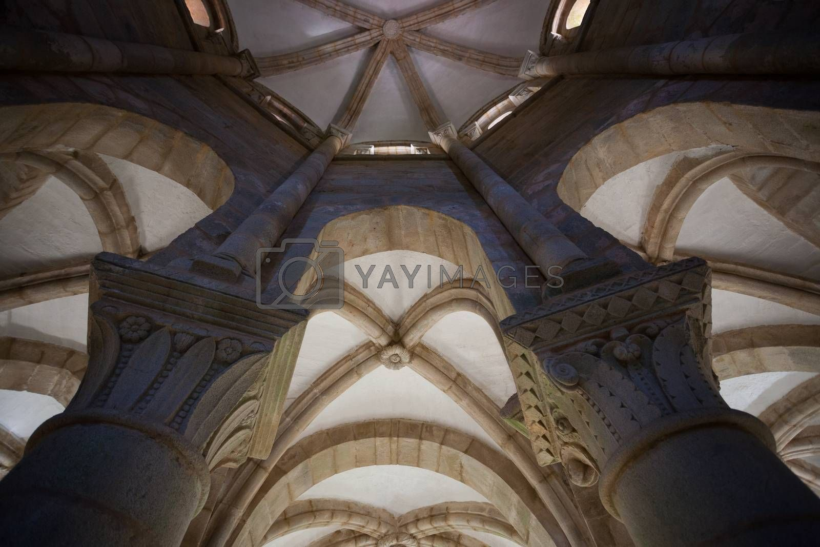 inside architectural cenital view from vaults with two capitals in the forefront taken in the romanesque monatery of Carboeiro in the province of Pontevedra Spain