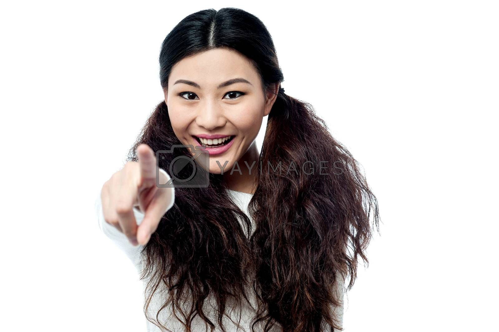 Fashion girl pointing you out by stockyimages