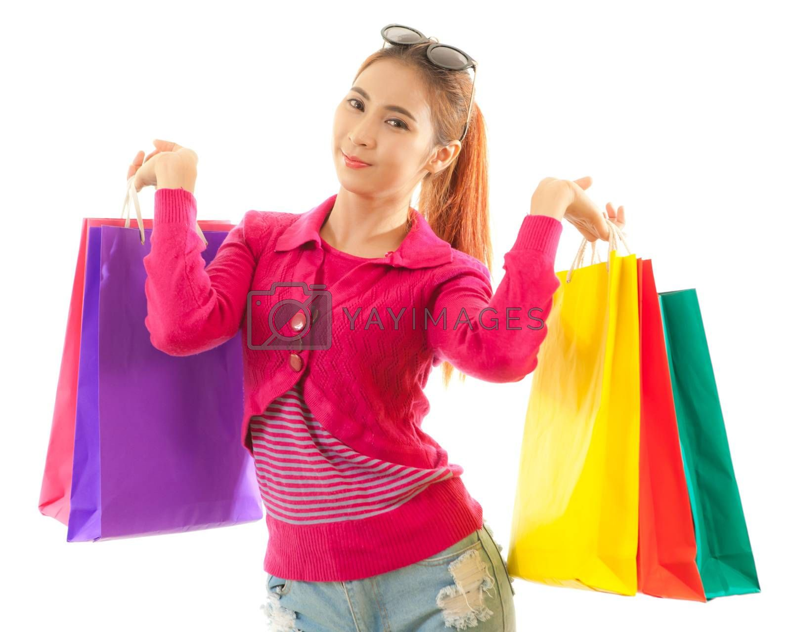 Royalty free image of Woman holding shopping bags by witthaya
